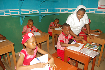 Sister Magdalene Akpan working with students in classroom