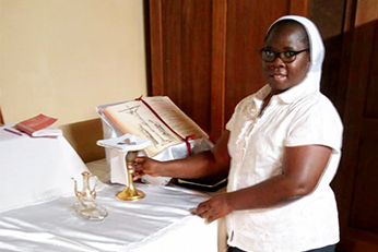 Sister assisting with communion distributionin sacristy during pandemic.