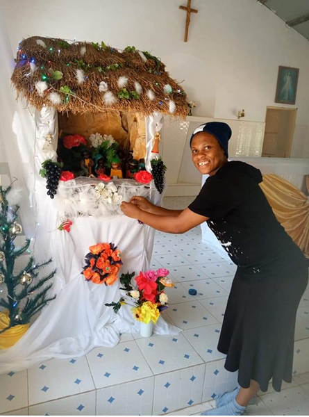 Sister Maryanne decorating the manger in the Church of Our Lady of Fatima