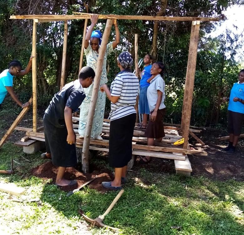 Postulants constructing chicken house