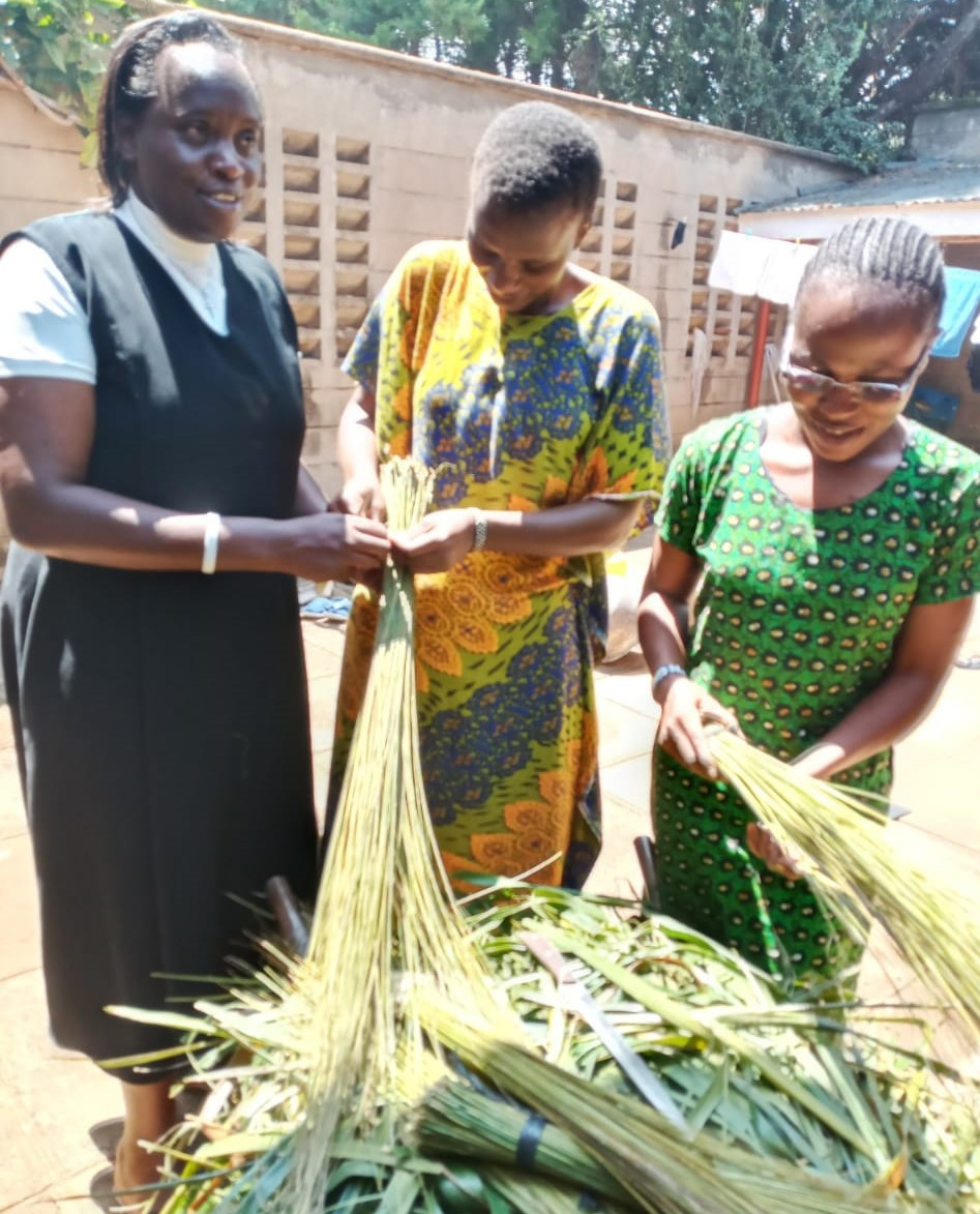 Sister Rose and Postulants making brooms