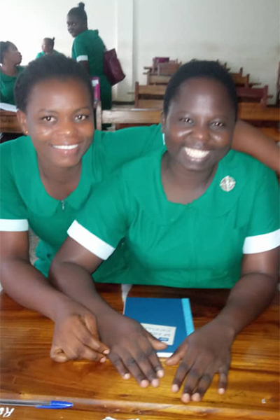 Sister Esther with her friend studying nursing