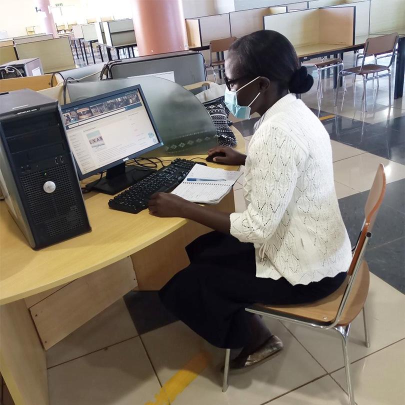 Sister Joy Adabo studying.