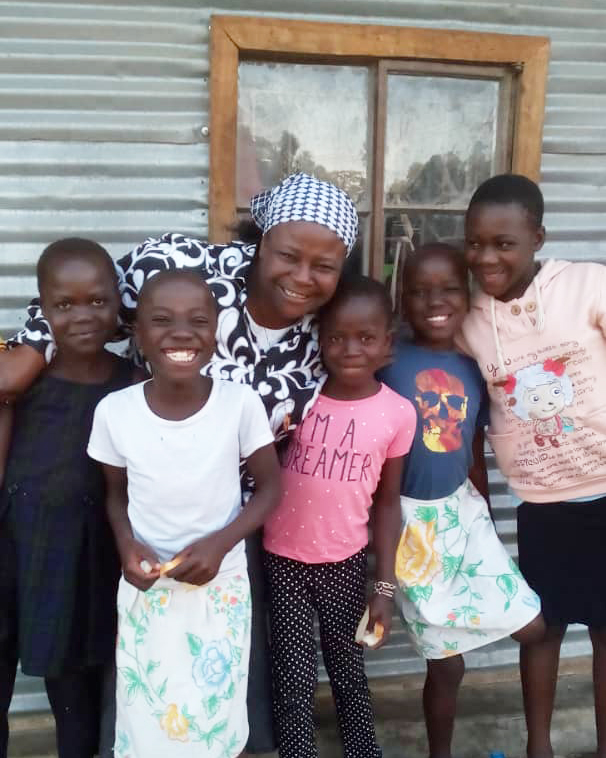 Sister and children at Notre Dame Children's Outreach Program