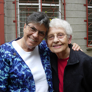 Sister Mara Frundt, left, says goodbye at the Kisumu postulancy as Sister Maris Simon leaves in 2015. They were two of the first SSND to go in mission to Kenya in 1974.
