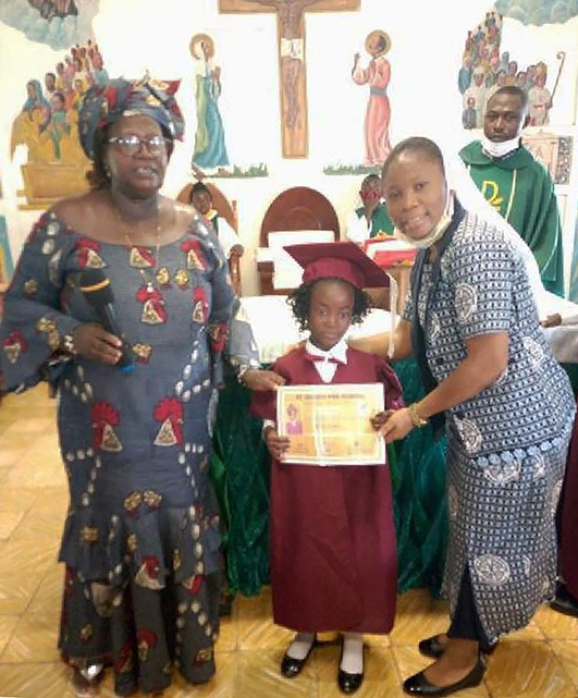 St. Josephs Preschool: pupil receiving a certificate of completion